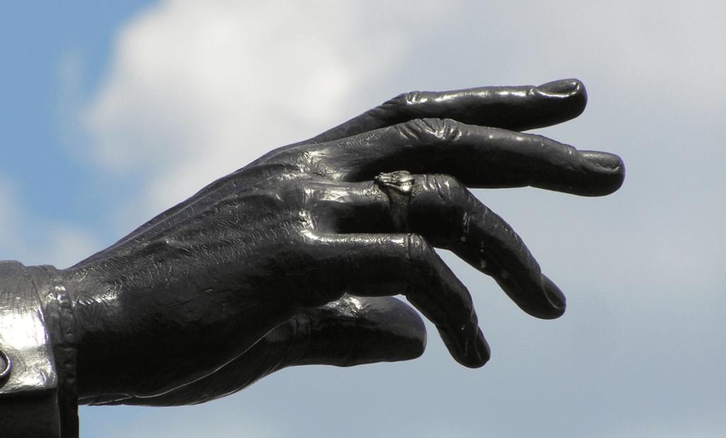 Walt Disney's outreached hand...wearing an Irish Claddagh ring!