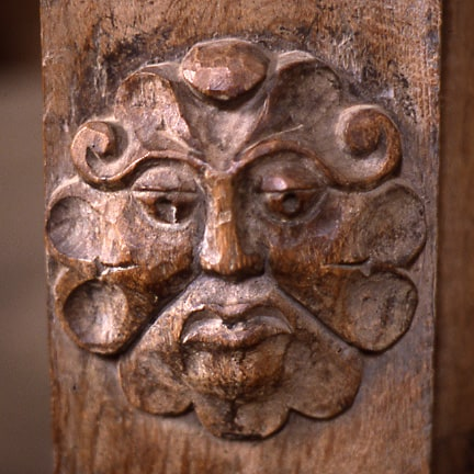 Green Man at a door