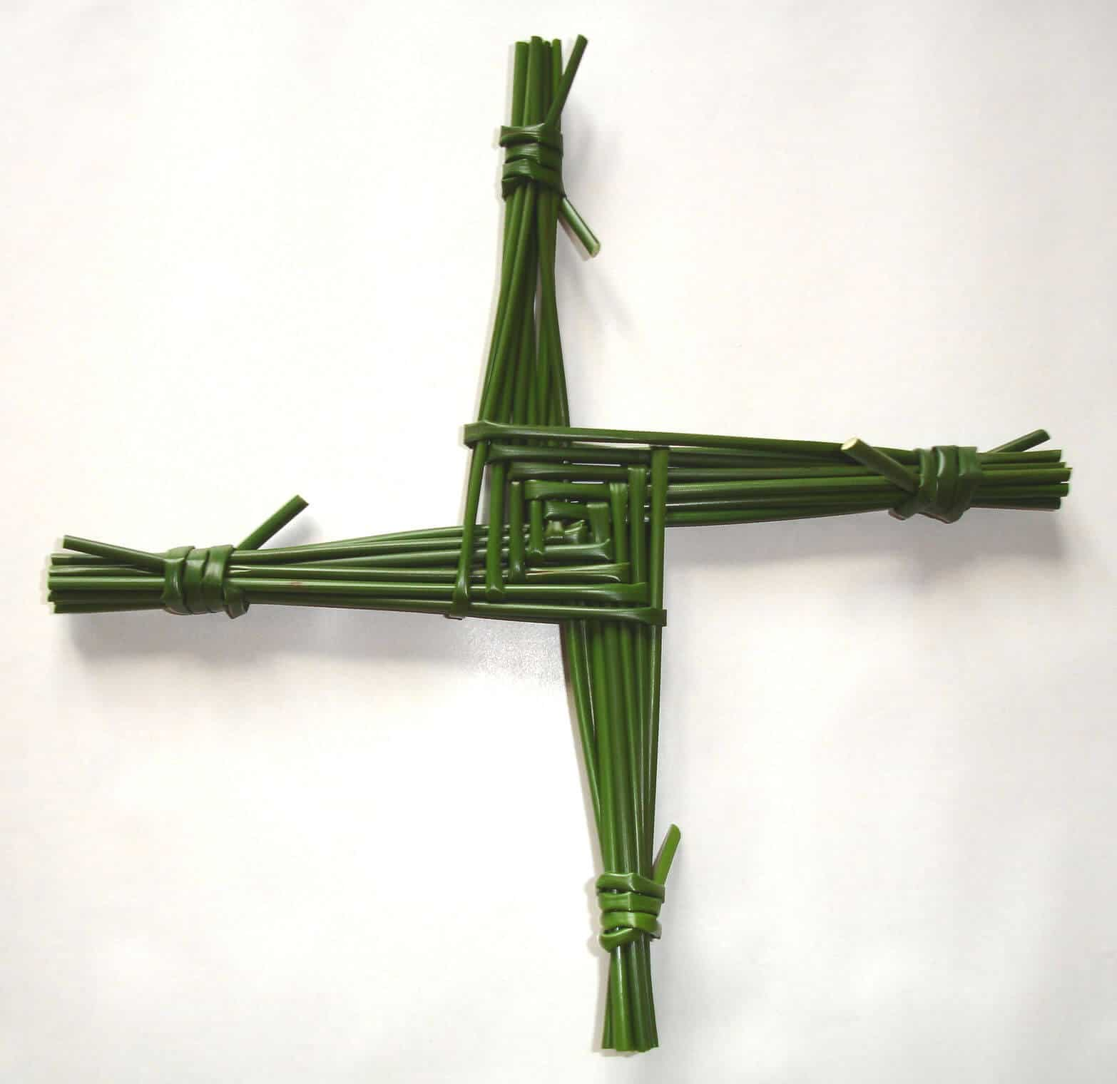 Saint Brigid's Cross green woven four arms tied at the ends and a woven square in the middle.