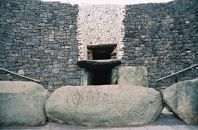 Entrance of Newgrange, Ireland showing the spiral of the Triskele