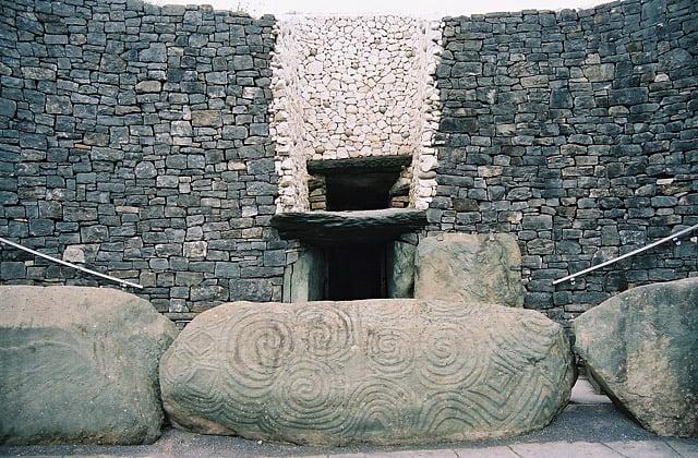Entrance of Newgrange, Ireland showing the spiral of the Triskele